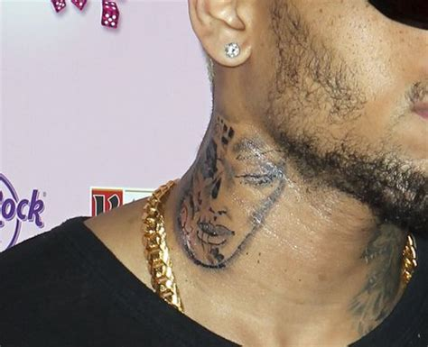chris brown neck tattoo meaning the don t me up singer s of a strange
