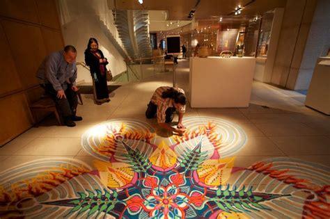 sand painting sand painter uses manhattan sidewalks as his canvas