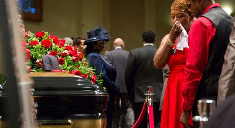 mourners gather for funeral of slain black missouri
