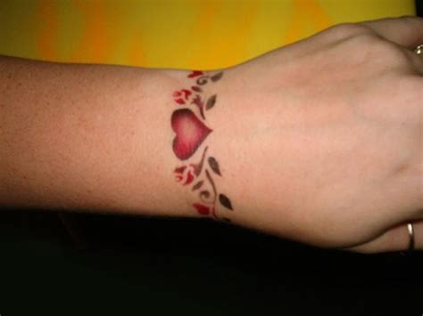flower tattoos for girls on wrist 47 attractive band tattoos for your writs