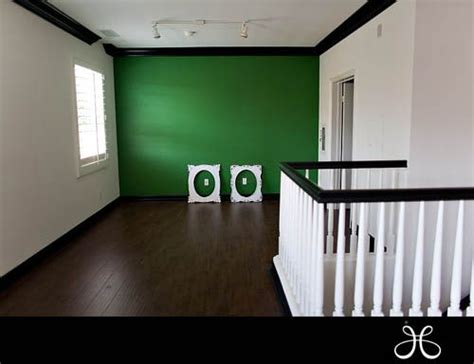 green accent wall apple green accent wall white walls and black trim new