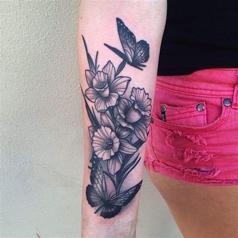 tattoo parlour fremantle black and grey daffodils with butterflies on arm tattoo by