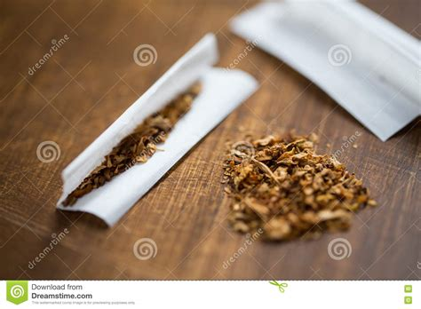 How To Make A Paper Cigarette - up of marijuana or tobacco cigarette paper stock