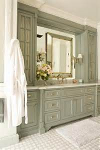 green gray bathroom vanity cabinets with gold leaf mirror