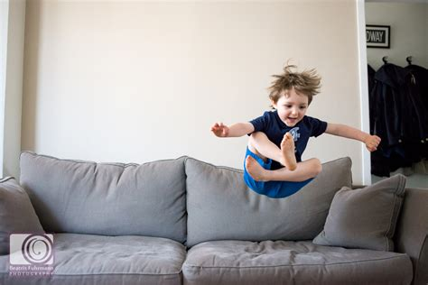 jumping on the sofa family photos in muswell hill beatrix fuhrmann photography