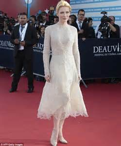 Stuns in an shimmering white dress at the 39th deauville film festival