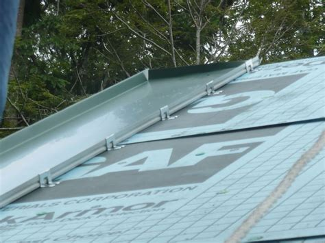 install  standing seam metal roof flashing