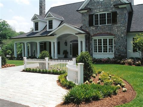 white picket fence and stone driveway traditional