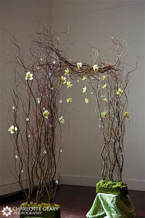 Wedding ceremony arch made of curly willow and green