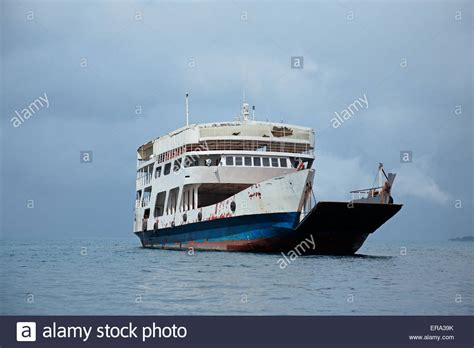 old ferry boat an old ferry boat on water with clouds zanzibar island