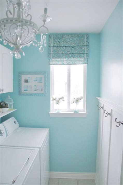sherwin williams swimming blue and white laundry room with chandelier color trends