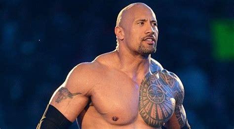 dwayne johnson tattoo story wwe news the rock alters his legendary brahma bull tattoo