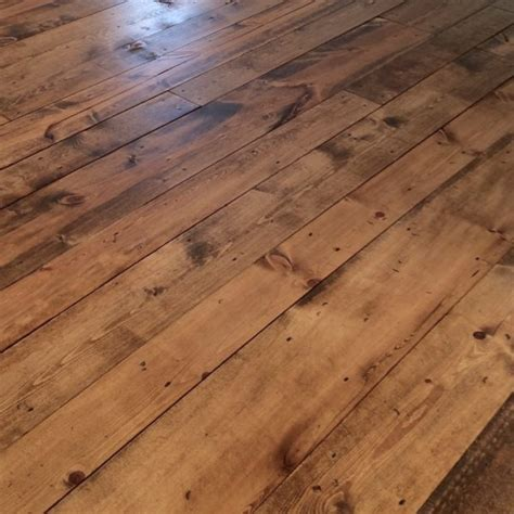 inexpensive flooring using 2 pine boards with