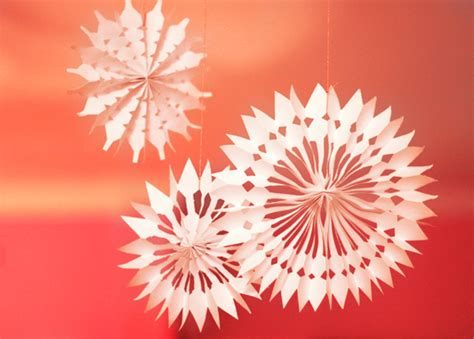 How To Make Paper Snowflake Decorations - diy paper snowflake decorations how about orange