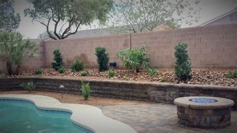 backyard install plants retaining wall pit pavers