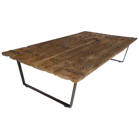 Door Coffee Tables Early Japanese Elm Door Coffee Table With Iron Nails On Custom Base For Sale At 1stdibs