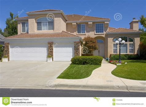 two story home two story stucco home with a street light royalty free