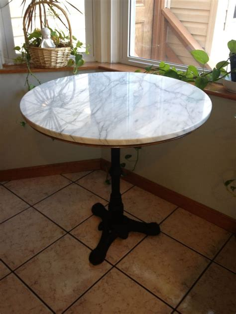 by the kitchen table marble bistro table for