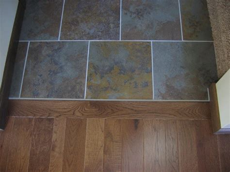 how to give new to an tile floor tile to wood floor transition doorway wood flooring