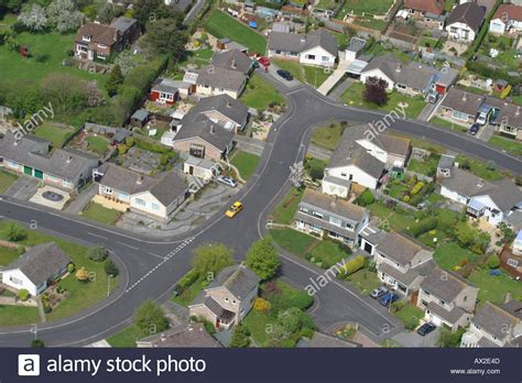 House Plan With Detached Garage aerial view of british town suburbs showing housing