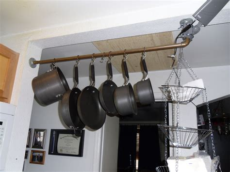 Make Your Own Pot Rack diy pot rack 1undomesticgoddess