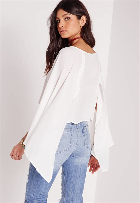 Cape Sleeve Blouse missguided cape sleeve tie front blouse in white lyst