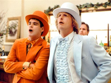 first posters for dumb and dumber tease familiar