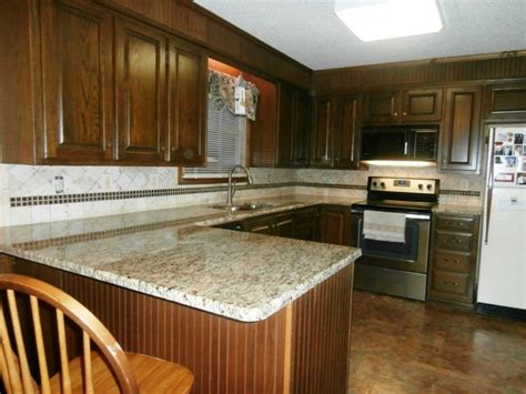 Kitchen St by St Cecilia Granite On Cabinets Traditional