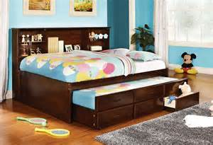 trundle bed with bookcase headboard cherry finish captain size bed w trundle 3 drawers