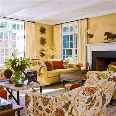 Living room design with butter yellow colored with gold tones modern house plans designs 2014