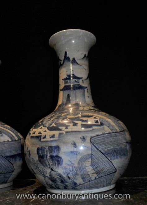 Porcelain Vases And Urns pair ming bulbous urns vases blue and white