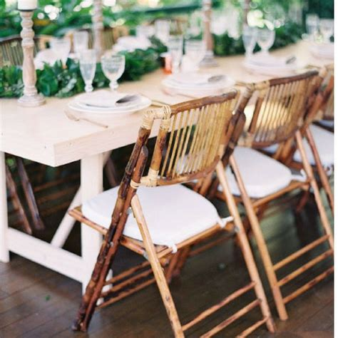 Natural bamboo folding chair bliss amp willow wedding styling