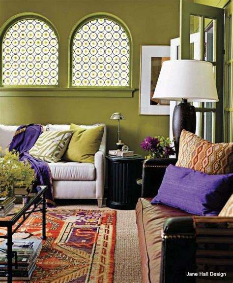 bohemian style living room with moss green walls and violet purple accents the mix of bright