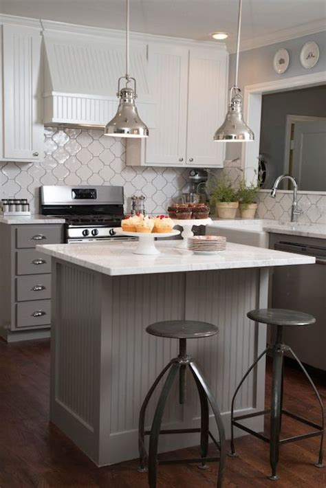 Fixer upper white and grey kitchen features white beadboard upper