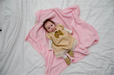 baby sleeping  girl  gray floral textile