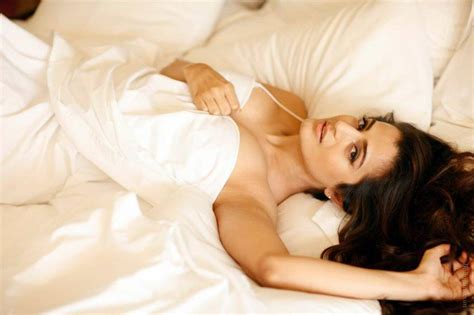 hot in bed amisha patel sexy picture in bed sheet bra visible hq