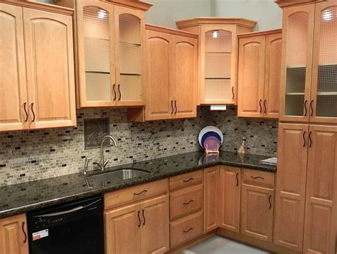 backsplash ideas  black granite countertops  maple