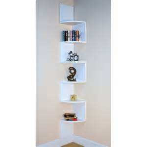 furniture floating white wooden corner bookcase with six triangle shelves on white wall