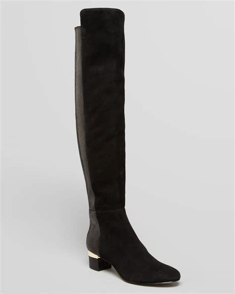 michael michael kors flat boots alaysia in black lyst