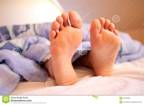 feet in bed bare feet in bed royalty free stock image image 27978336