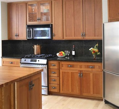 backsplash ideas  black granite countertops  cherry