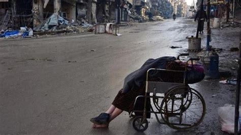 emirates wheelchair assistance pictures woman in eastern aleppo dies in wheelchair as