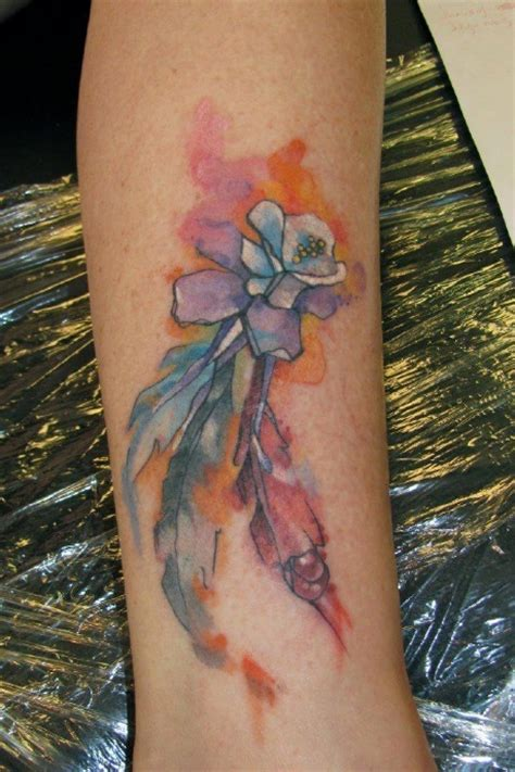 columbine tattoo colorado state flower columbine with feathers