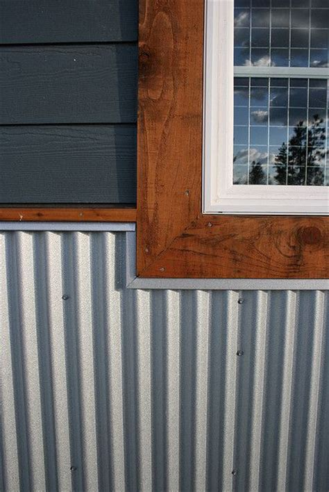 log siding in tin cedar trim and metal skirting meet oh dear lord this