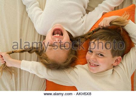 pix brother pulling sister pubic hair brother pulling his sister s hair stock photo royalty