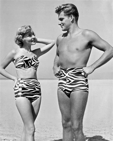 pic of men in female swinsuits a young man and woman display the latest in swim wear with