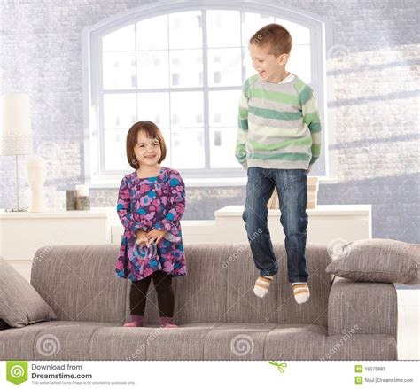 no jumping on the couch kids playing on sofa stock photos image 18075883
