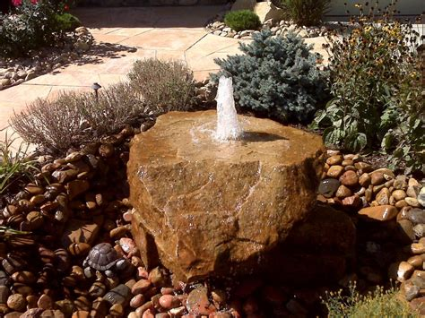 Bubbling Rock Waterfeature Provided By Wildflower Rock Features In Gardens