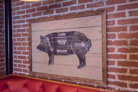 photos the polite pig opens at disney springs blog mickey