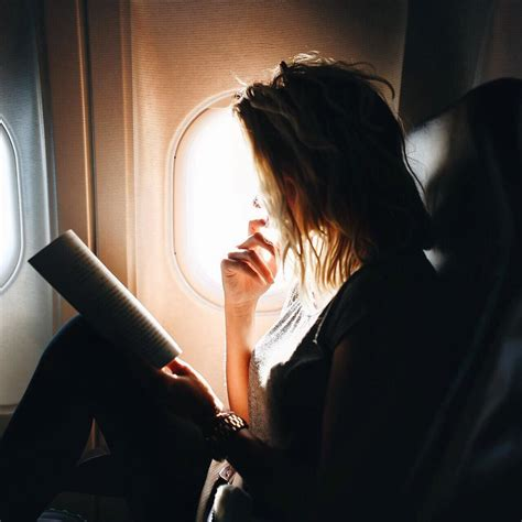 libro a woman looking at 15 essentials for a long haul flight